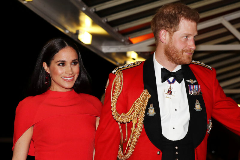 Meghan Markle Stuns in Red Caped Dress From Safiyaa